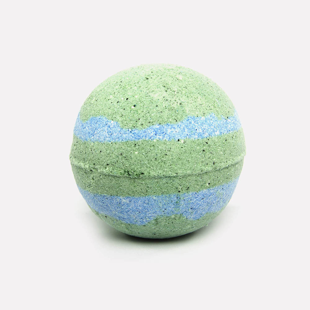 Blue and Green rippled bath bomb on relax candle and bath