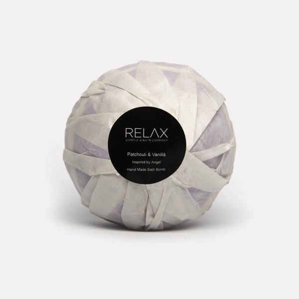 Patchouli and vanilla hand made bath bomb on relax candle and bath