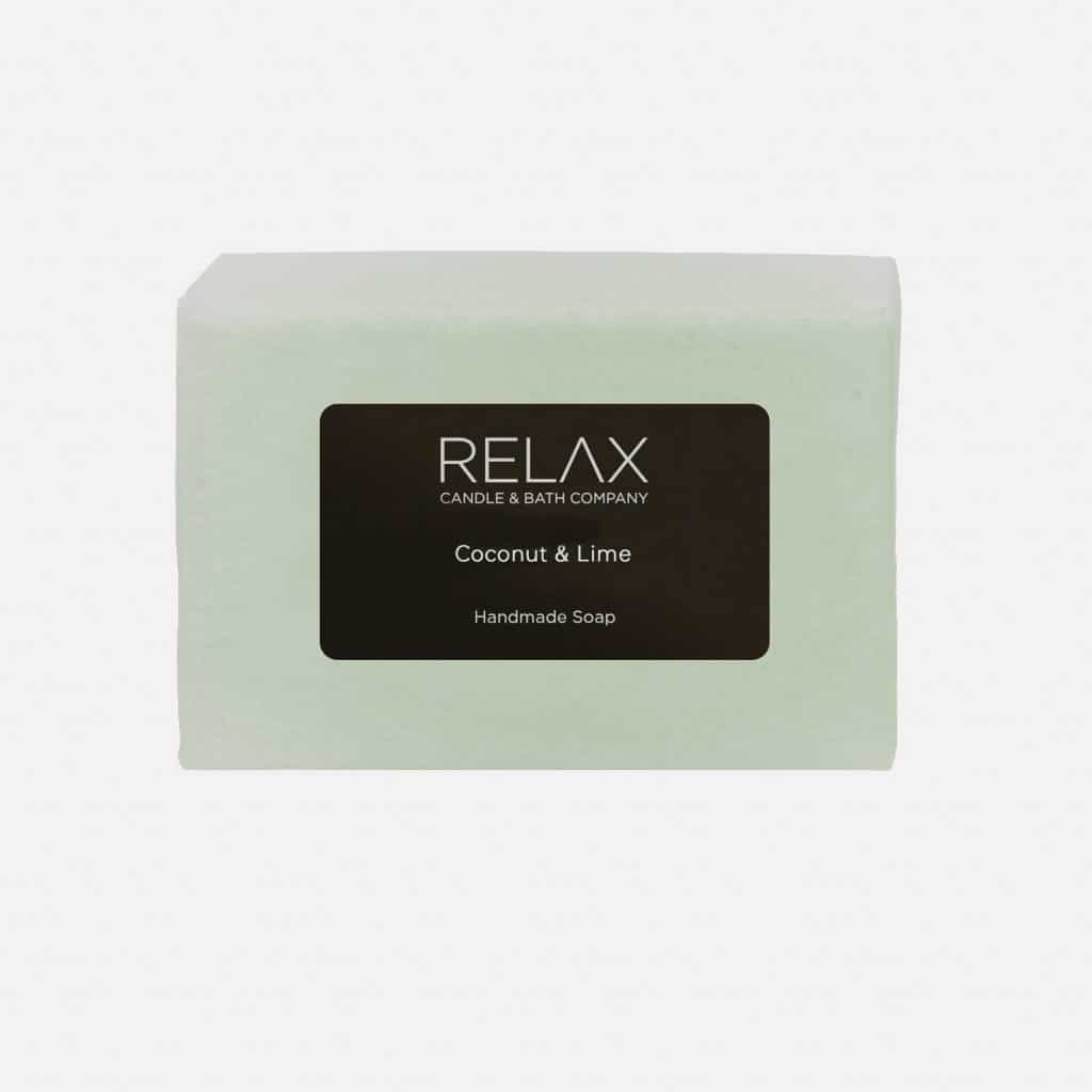 Coconut and lime soap bar on relax candle and bath
