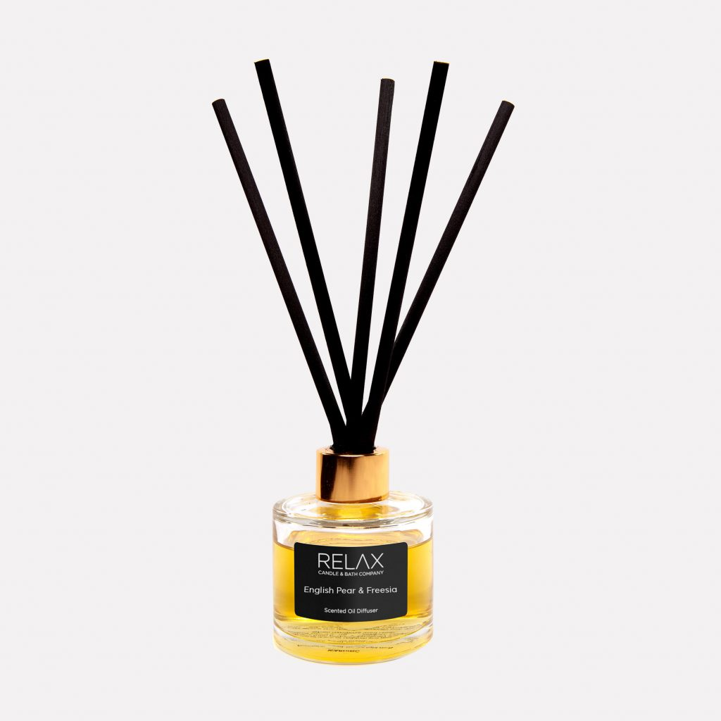 English pear and freesia scented reed diffuser on relax candle and bath