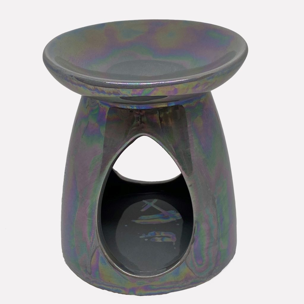 Grey iridescent teardrop burner on relax candle and bath