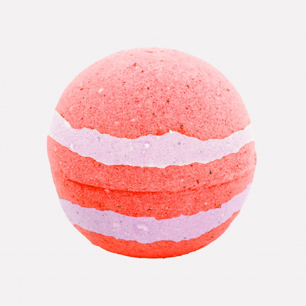 Pink and yellow unwrapped relaxing bath bomb