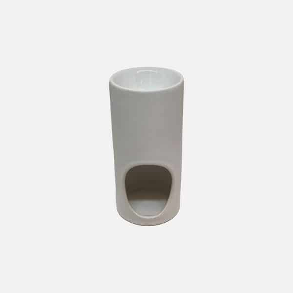 Tall white oil burner relaxing scents on relax candle and bath