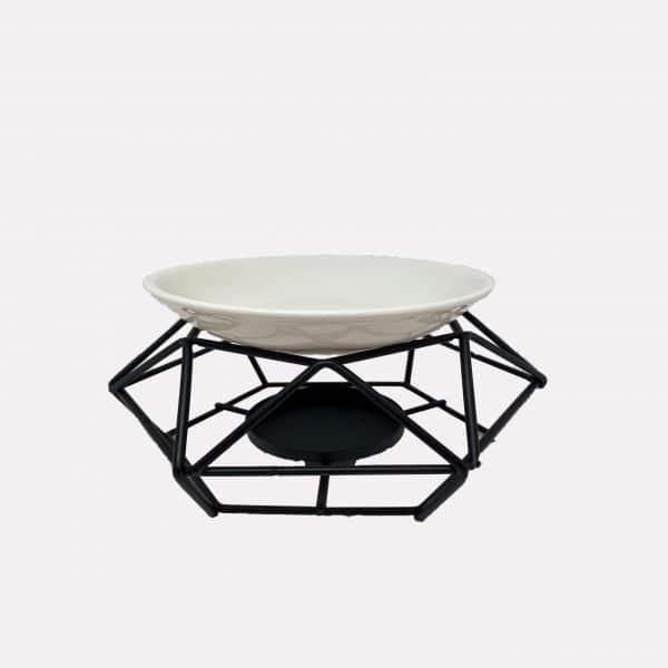 Black geometric oil burner on relax candle and bath